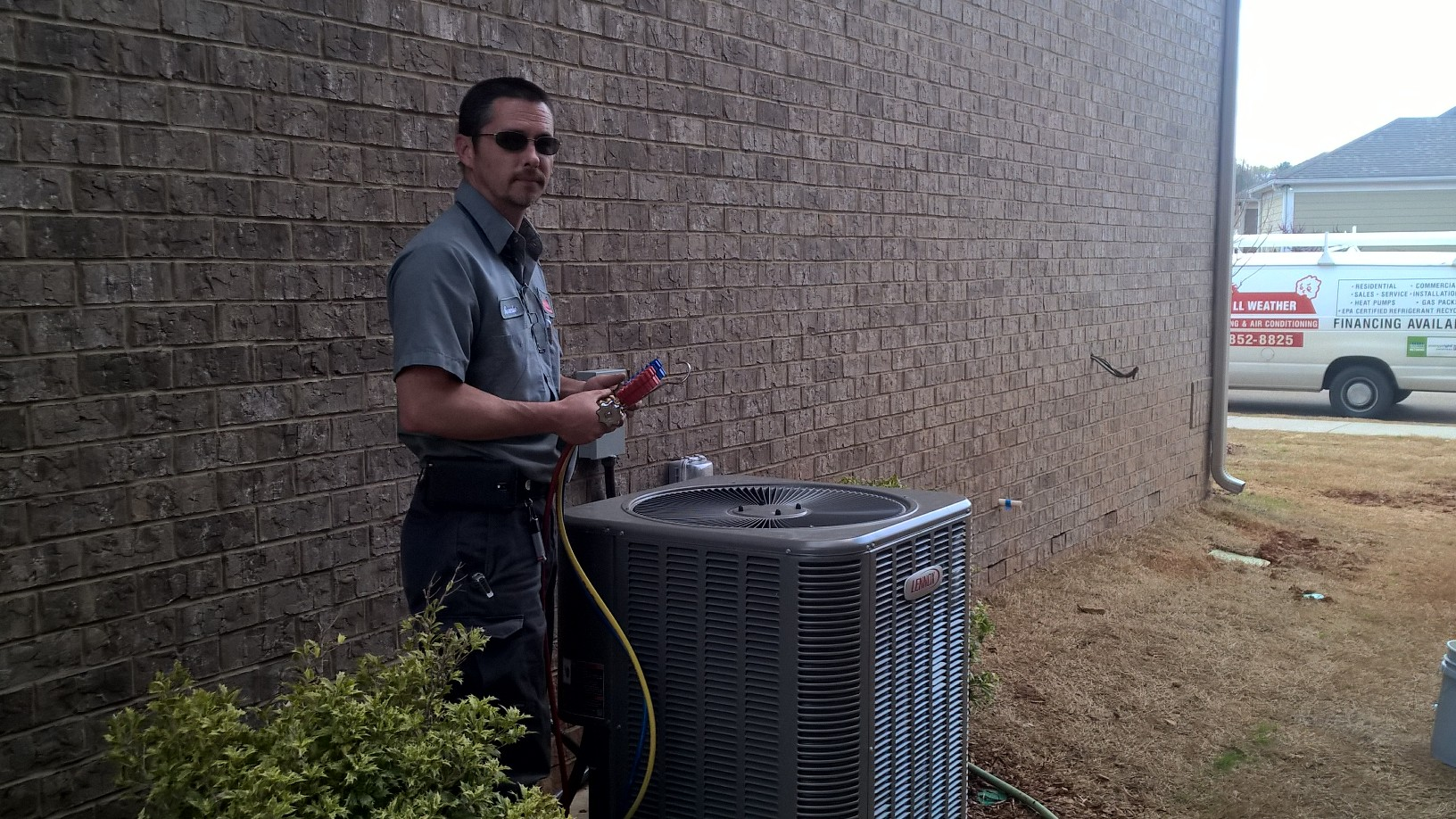 Ronnie Austin is setting and starting up a Lennox heat pump